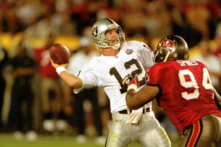 Oakland Raiders Rich Gannon looks to pass the ball off in Super Bowl XXXVII (37) against the Tampa Bay Buccaneers on  Jan. 26, 2003, in San Diego.