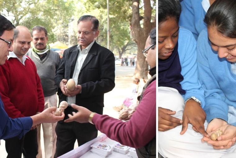 Above, Sunny Kattukaran of V4L ('We for Life') explains the dangers of abortion at a street exhibition in New Delhi in 2014. The exhibit included models of unborn babies, shown in detail at right. Such outreach is meant to share the dignity of life amid formal or informal policies targeting population control.