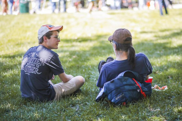 A Christ in the City missionary spends time with a friend during lunch at Denver's Civic Center Park.