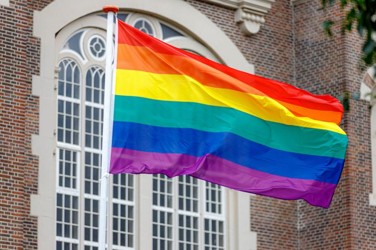 Rainbow flag outside of a building.
