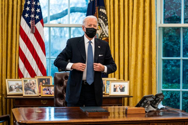 President Joe Biden stands after signing an executive order in the Oval Office of the White House on January 25, 2021 in Washington, DC. President Biden signed an executive order repealing the ban on transgender people serving openly in the military.