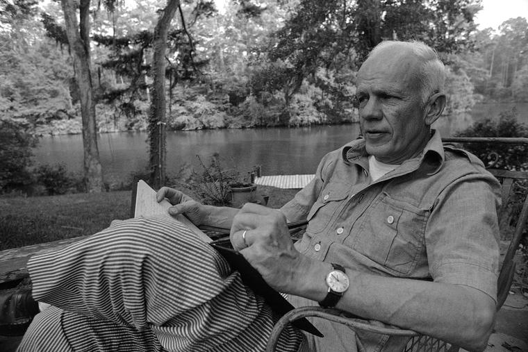 Novelist Walker Percy sits in his Covington, La., yard, June 8, 1977.