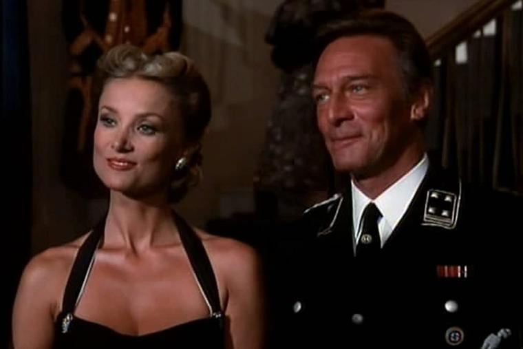 Christopher Plummer stands next to Barbara Bouchet in a scene of 'The Scarlet and the Black' (1983).