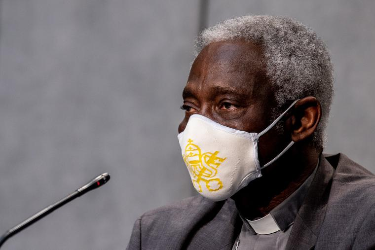 Cardinal Peter Turkson, prefect of the Dicastery for Promoting Integral Human Development, shown wearing a mask during a news conference on July 7, 2020, says the Vatican is committed to participating in dialogue about economic matters that impact the worldwide common good.