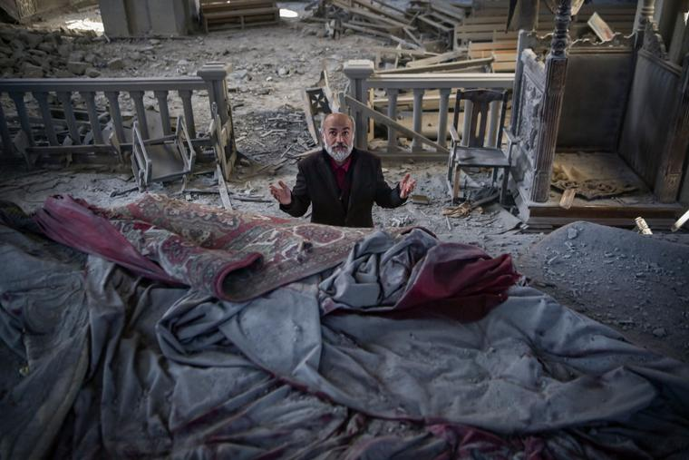 Arthur Sahakyan, 63, prays inside the damaged Ghazanchetsots (Holy Saviour) Cathedral in the historic city of Shusha, some 15 kilometers from the disputed Nagorno-Karabakh province's capital Stepanakert, that was hit by a bomb during the fighting between Armenia and Azerbaijan over the breakaway region, on October 13, 2020.