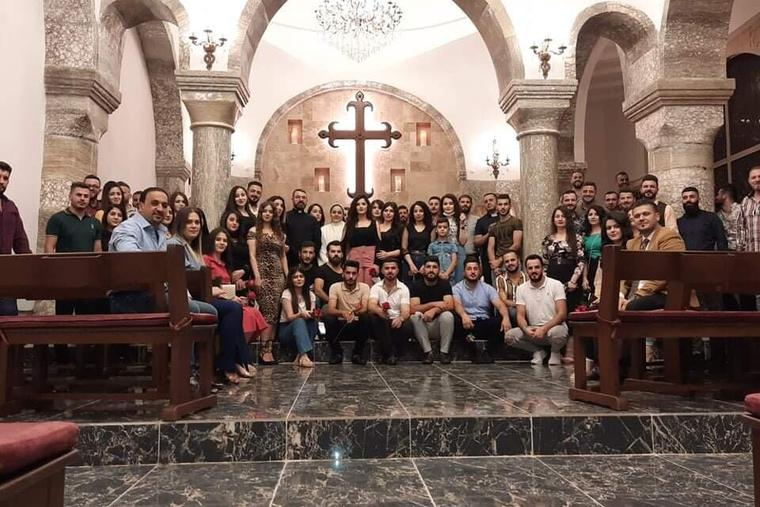 Young adults at St. George Chaldean Catholic Church in Telskuf, Iraq.