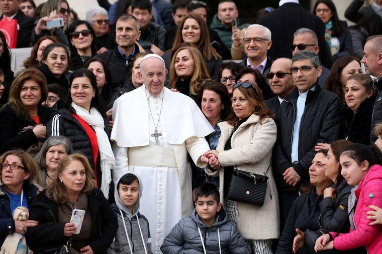 Pope Francis poses with faithful from Iraq in St. Peter's Square during his weekly audience  on February 26, 2020 in Vatican City, Vatican.