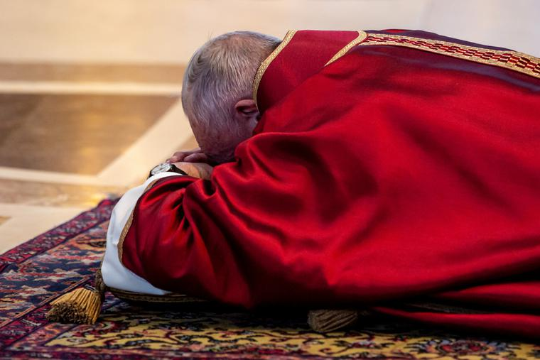 Pope Francis venerates the Cross during the liturgy for the Lord's Passion in St. Peter's Basilica on Good Friday.