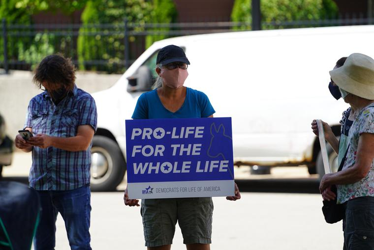 Pro-lifers hold a Democrats for Life sign in Milwaukee, Wisc.