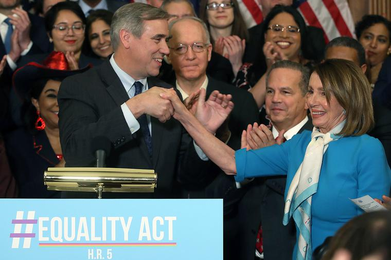 Sen. Jeff Merkley (D-OR) introduces House Speaker Nancy Pelosi (D-CA) during a news conference where House and Senate Democrats introduced the Equality Act on March 13, 2019, in Washington, D.C. The 2019 bill failed after resistance from President Donald Trump and a Republican-led Senate, but a new version of the legislation is being advanced in the 117th Congress.