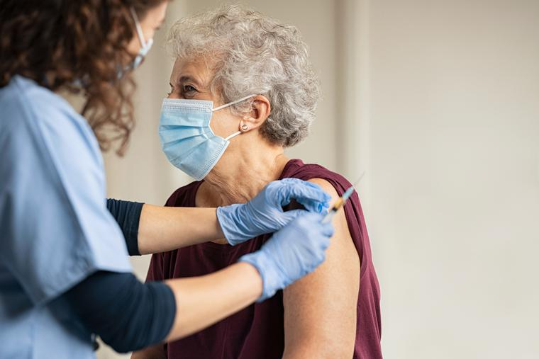 An elderly patient receives the COVID vaccine.