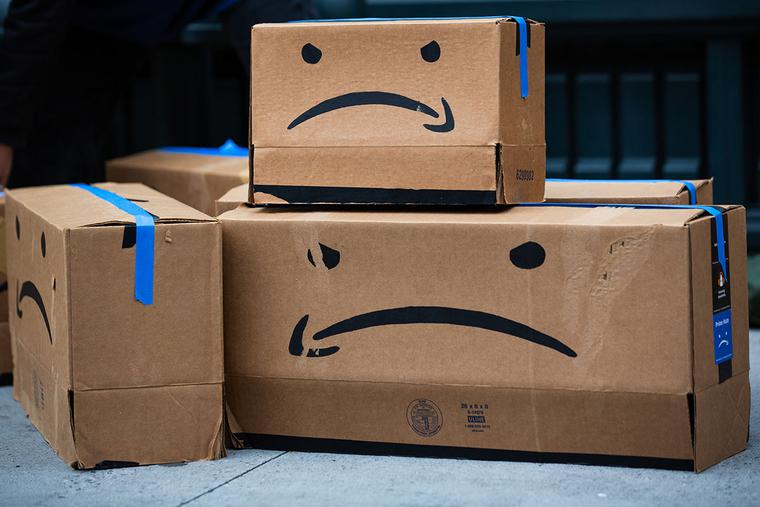 Cardboard boxes made to resemble Amazon packages are seen during a labor protest outside the home of Amazon CEO Jeff Bezos in New York on Dec. 2.