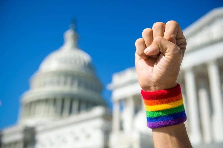 A LGBT activist outside the United States Capitol building and Supreme Court.