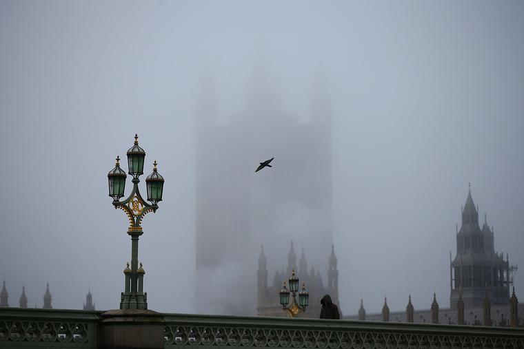Fog settles over the Houses of Parliament on Dec. 28 in London, shortly after the UK government nixed a plan to allow household mixing in England for five days over Christmas.