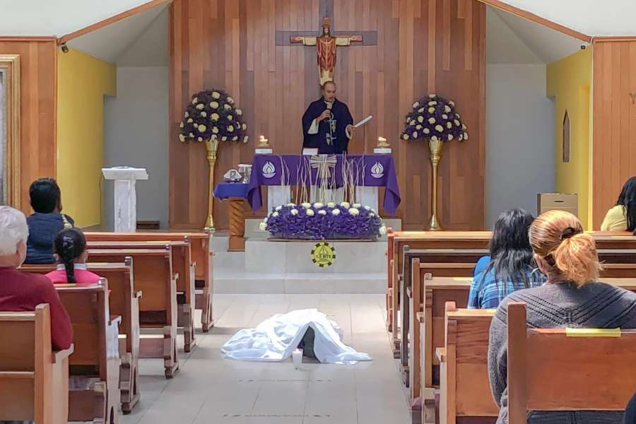 Fr. Sajid Lozano says a funeral Mass for Juan, whose body is in the nave, in Jesus the Priest parish in Mexico City, Feb. 21, 2021.