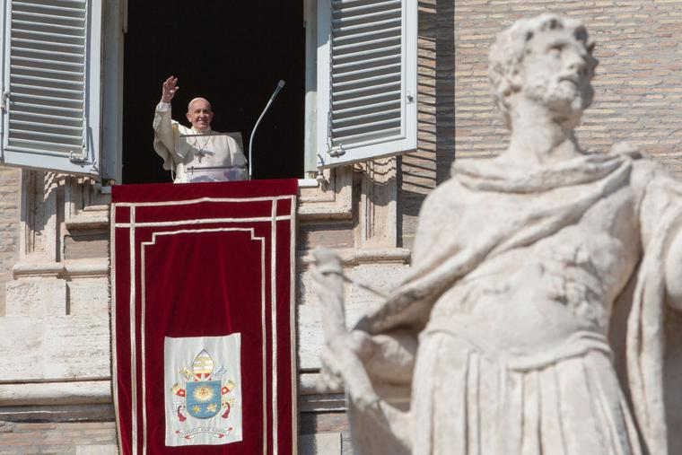 Pope Francis waves to pilgrims after the Sunday Angelus in St. Peter's Square, Oct. 27, 2019.