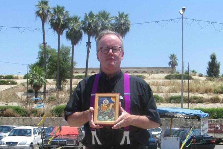 Father Benedict Kiely is shown standing opposite the tomb of Jonah in Mosul (Nineveh), Iraq, in July 2019. He holds an icon of the prophet Jonah. Father Kiely makes frequent trips to Iraq to help the beleaguered Christians there.