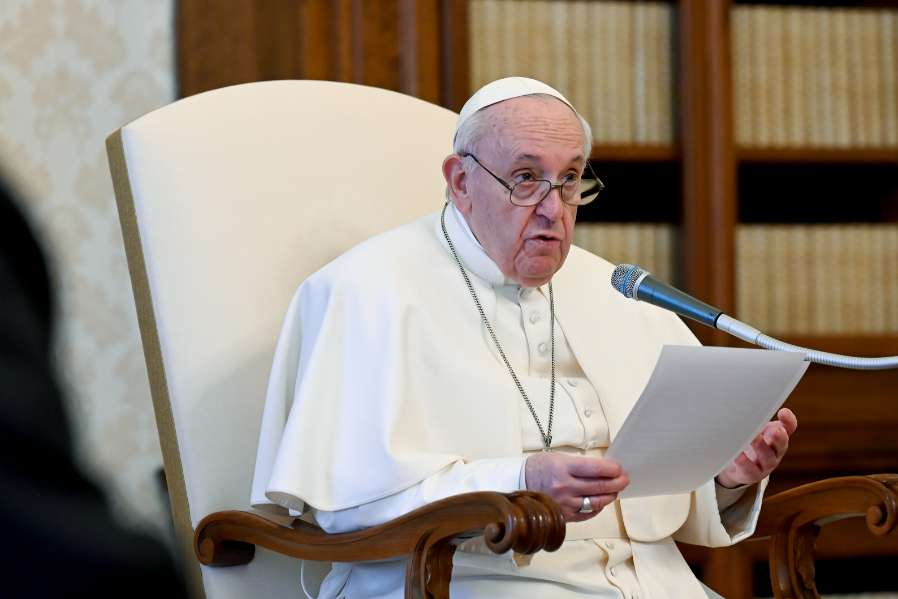 Pope Francis delivers his weekly general audience address in the library of the Apostolic Palace.