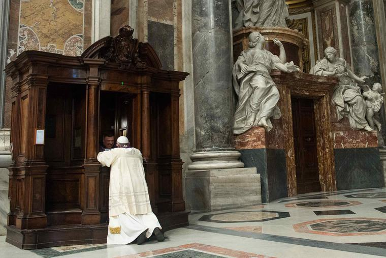Pope Francis goes to Confession during a penitential celebration at St. Peter's Basilica on March 28, 2014.