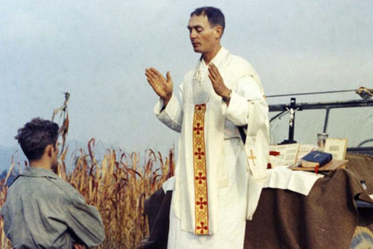 Father Emil Kapaun celebrating Mass using the hood of a Jeep as his altar, Oct 7, 1950