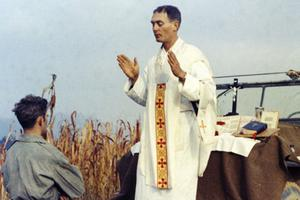 Father Emil Kapaun celebrates Mass using the hood of a Jeep as his altar on Oct. 7, 1950.
