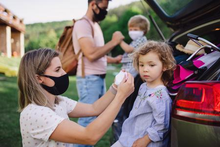 A family prepares to go indoors amid the COVID pandemic, putting masks on their two small children.