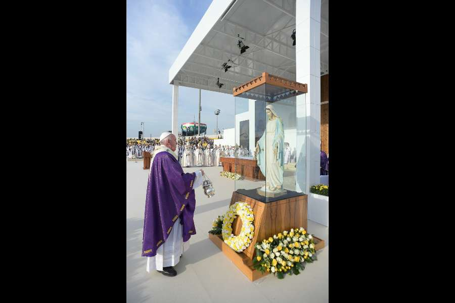 Pope Francis incenses a once-desecrated statue of the Virgin Mary from Karemlesh during his Mass in Erbil, Iraq, March 7, 2021.