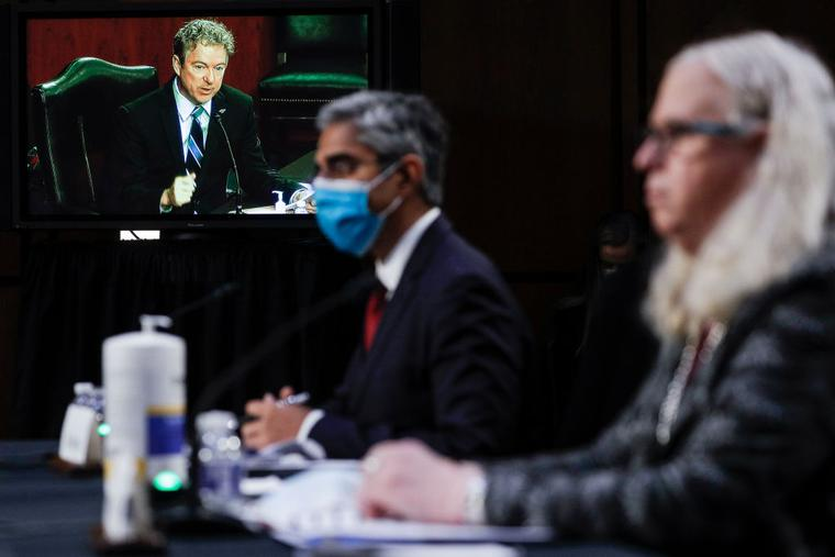 US Senator Rand Paul (on screen), Republican of Kentucky, questions Vivek Murthy (C), nominee for US Surgeon General, and Rachel Levine (R), nominee for Assistant Secretary of Health and Human Services, during a Senate Health, Education, Labor, and Pensions Committee nomination hearing on Capitol Hill in Washington, DC, on February 25, 2021.