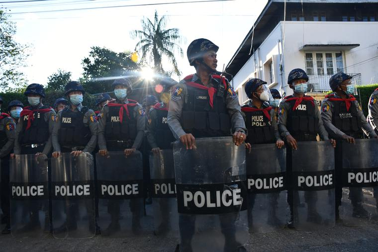 Police create a barrier during protests in Burma.