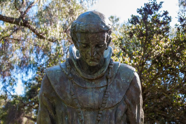 A statue with the bowed head of Father Junipero Serra is shown at the Serra Mission Museum.