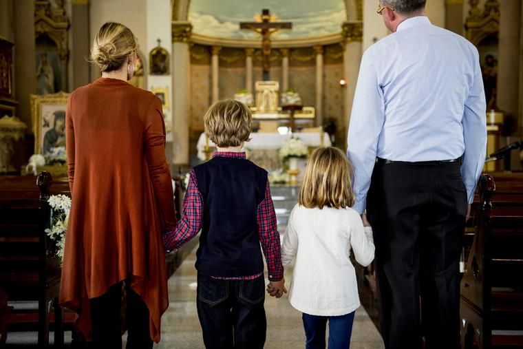A family attends Sunday Mass.