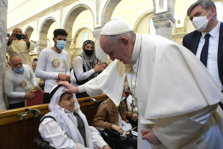 Pope Francis blesses a young boy during his visit to the Church of the Immaculate Conception in Bakhdida (Qaraqosh), Iraq, March 7.
