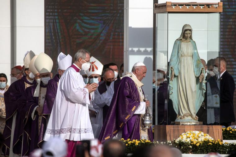 Pope Francis walks towards a statue that was rescued from a church destroyed by ISIS in the village of Karemlash while conducting a mass at the Franso Hariri Stadium on March 07, 2021 in Erbil, Iraq.