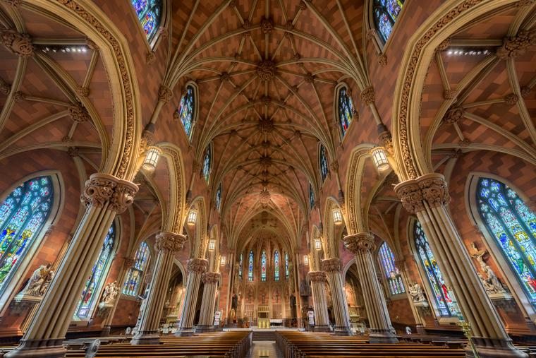 Stained glass windows and ceiling inside the historic Cathedral of the Immaculate Conception on Eagle Street in Albany.