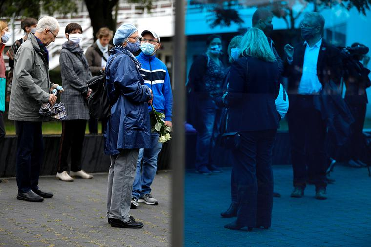 """People pay their respect at the T4 - Memorial and Information Point for the Victims of the Nazi Euthanasia Programme in Berlin on Sept. 4, 2020. Administrators and doctors of the Nazi regime organized the mass murder of people with intellectual disabilities and mental illness. The annihilation of more than 70,000 patients in institutions was later named """"Aktion T4"""" after the address of the program headquarters."""