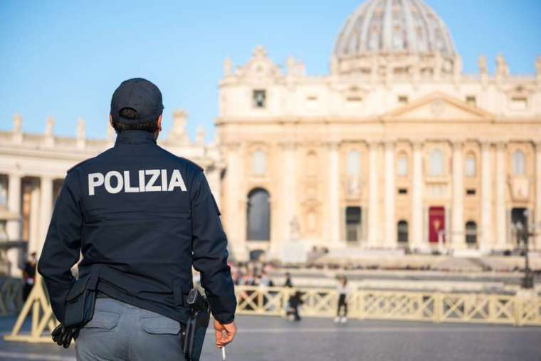 A police officer is on duty at St. Peter's Square in Vatican City.