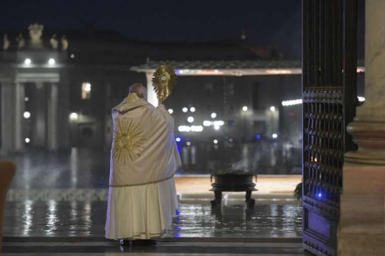 Pope Francis gives an extraordinary Urbi et Orbi blessing from the entrance of St. Peter's Basilica to an empty square amid the coronavirus pandemic on March 27, 2020.