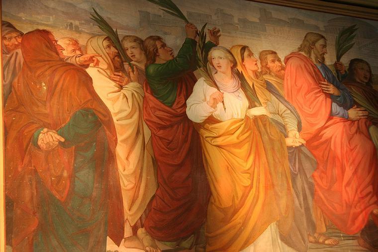 Jesus entering Jerusalem on Palm Sunday.