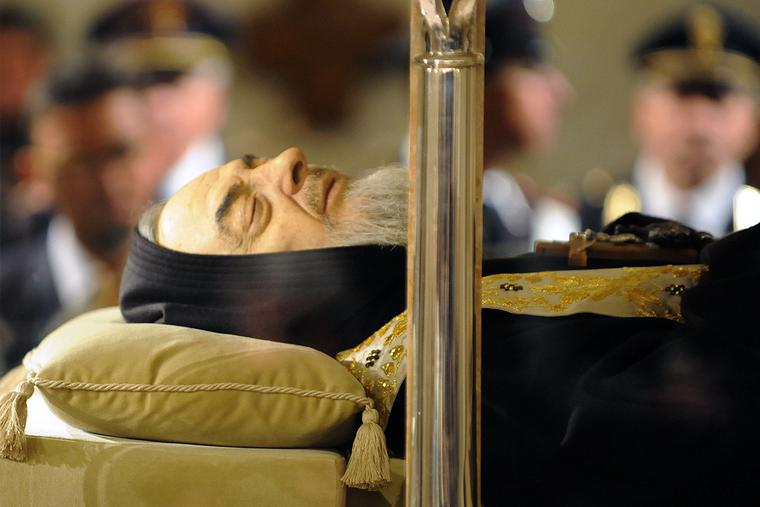 The body of Padre Pio is displayed for the veneration of the faithful in a part-glass coffin in the crypt of the old Church of St. Mary of Grace at San Giovanni Rotondo, Italy, on April 24, 2008.