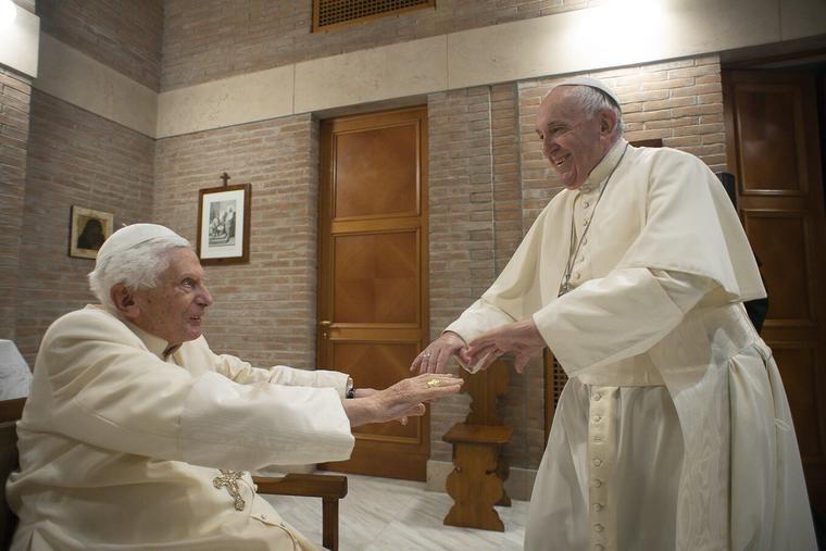 Pope Francis greets Benedict XVI after the creation of new cardinal Nov. 28, 2020.