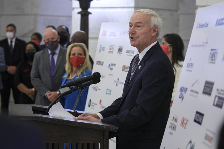 Arkansas Gov. Asa Hutchinson speaks Wednesday Aug. 19, 2020, in Little Rock, Ark., during a news conference at the Capitol to reveal a draft of a proposed hate-crime law that will be considered during the next legislative session.
