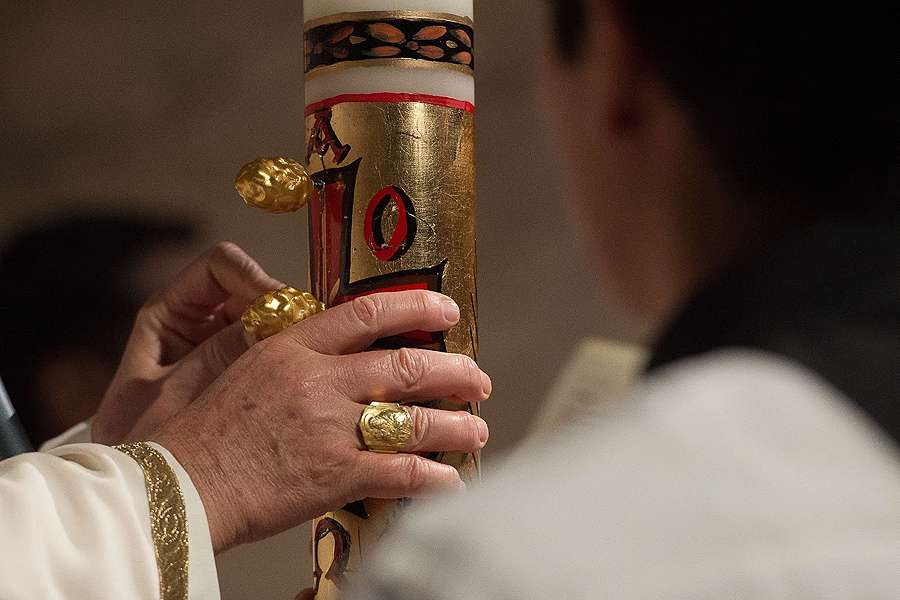 Pope Francis holds the Easter Candle At Easter Vigil Mass In St Peters Basilica on April 4 2015.