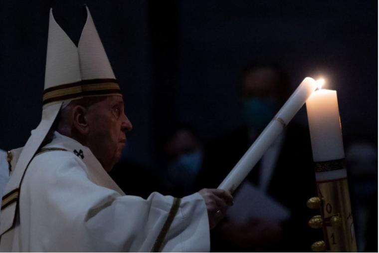Above, Pope Francis lights the Easter candle at the Easter vigil Mass in St. Peter's Basilica on April 3. Below are pictorial highlights of other moments of the Mass.