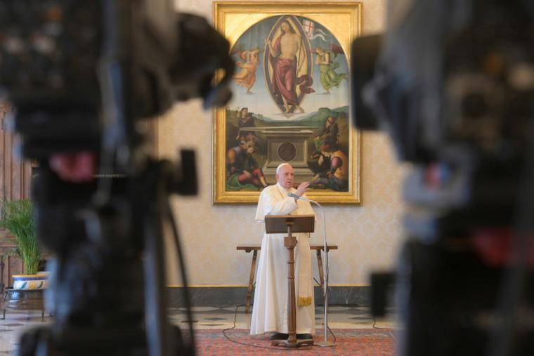 Pope Francis delivers a Regina Coeli address in the library of the Apostolic Palace.