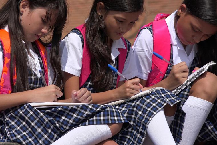 Catholic school girls work on homework after class.