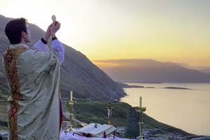 Fr. Gerard Quirke celebrated Easter Sunday Mass at dawn from Keem Bay, Achill Island, an ancient site upon a cliff in Ireland.