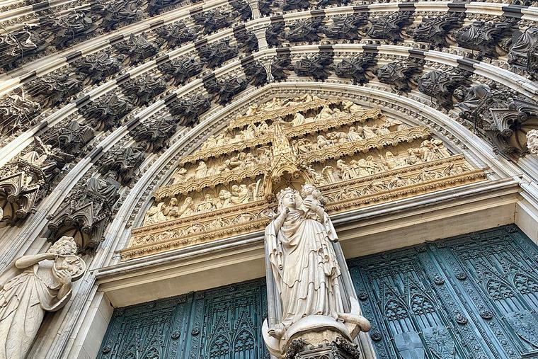 Crescent moon Madonna above the left main entrance   of Cologne Cathedral.
