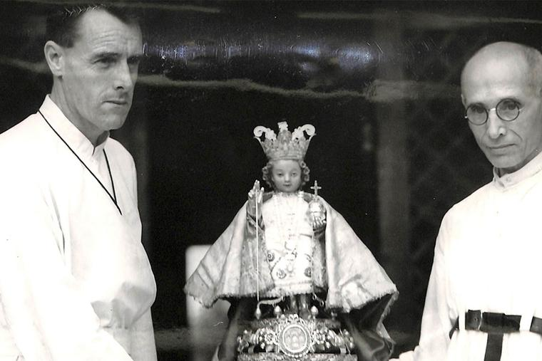 The statue of the Santo Niño is safely returned to Cebu City in the Philippines on April 3, 1945. Father McHugh of Ireland (l) and Augustinian Father Moran of Spain, hid the statue in the hills throughout the Japanese occupation of Cebu Island during World War II.