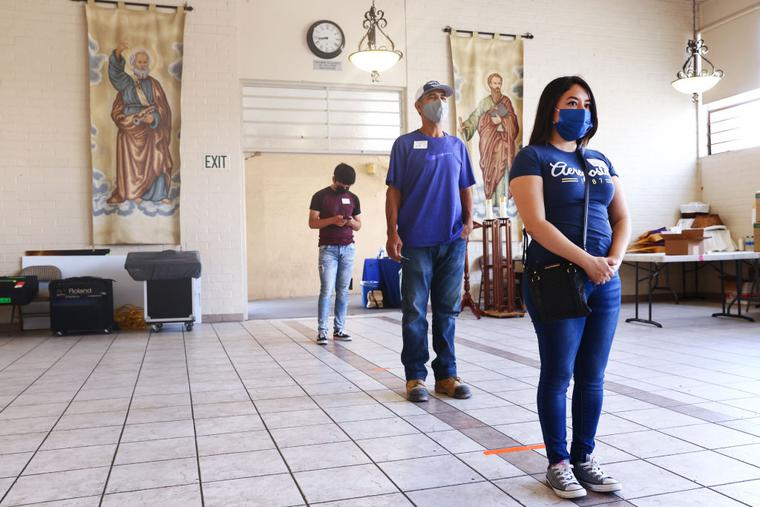 People wait to receive their first dose of the Pfizer COVID-19 vaccine at a clinic targeting minority community members at St. Patrick's Catholic Church on April 9, 2021 in Los Angeles, California.