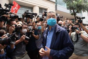 Hong Kong media tycoon and founder of Apple Daily newspaper Jimmy Lai Chee Ying arrives at the West Kowloon Magistrates' Court.